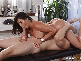 Tanned woman rides the masseur's huge learn of