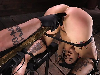 Tattooed bitch with juicy ass Joanna Punter gets punished connected with the dark BDSM room